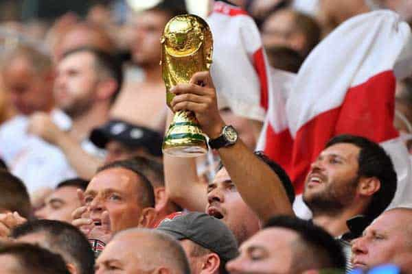 Fans hold the World Cup trophy