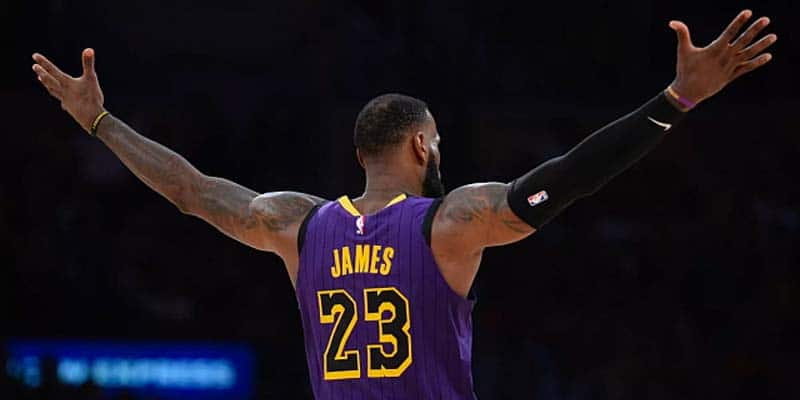 LeBron James facing away from the camera with his arms raised outwardly