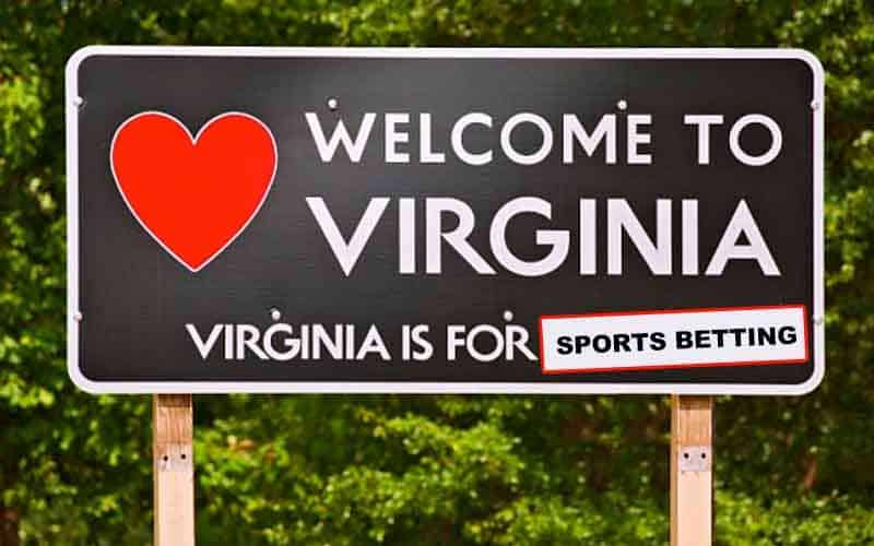 a road sign that states welcome to Virginia, Virginia is for sports betting