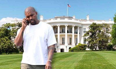 Kanye West in front of the White House talking on a cell phone