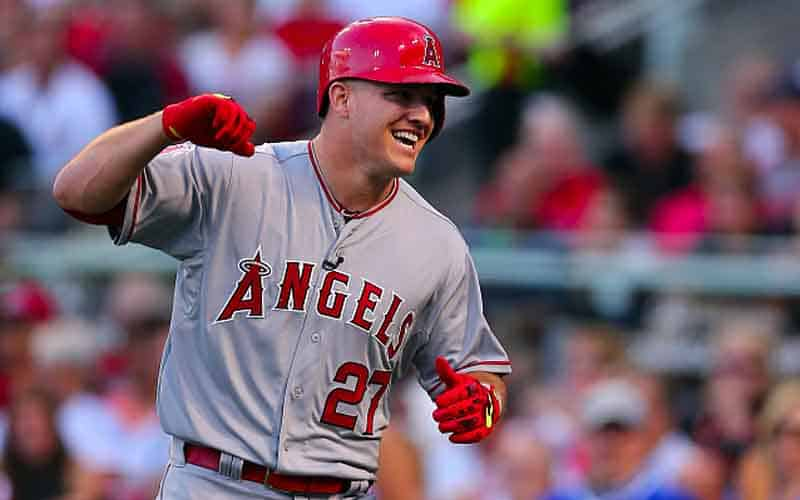 MLB baseball player Mike Trout pumping his fist in celebration