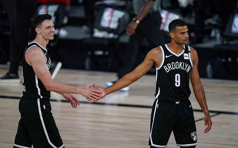 two Brooklyn Nets players giving each other a five