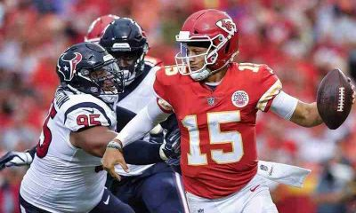 Patrick Mahomes getting tackled by a Texans player
