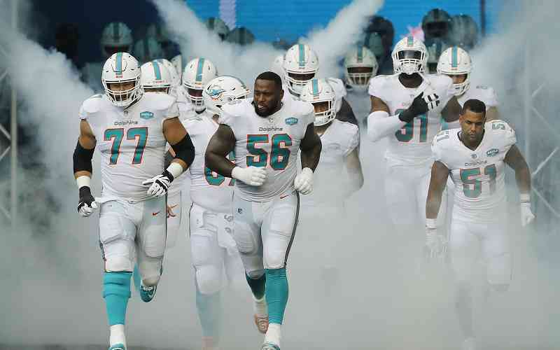 Miami Dolphins running onto the field