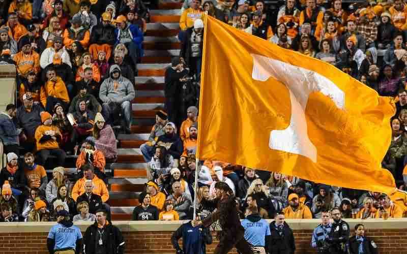 Tennessee Volunteers flag being ran around the field after a score