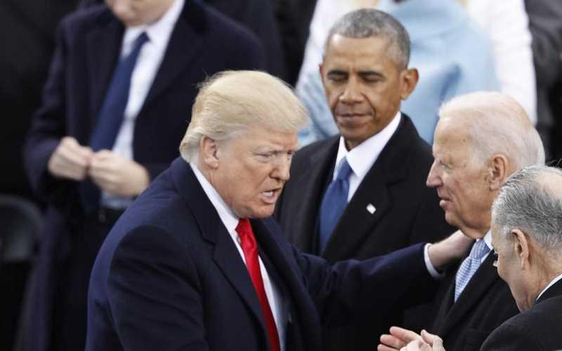 Trump shaking hands with Biden