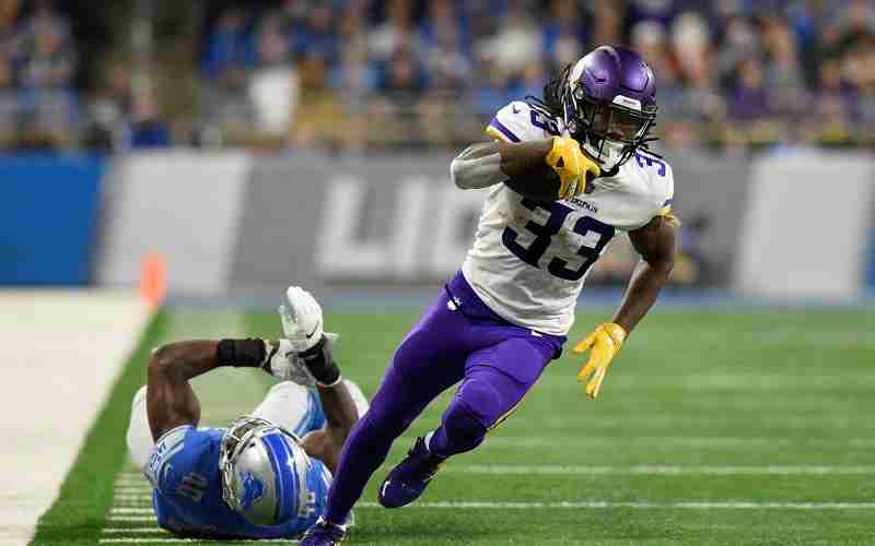 Dalvin Cook of the Vikings running past a Lions defender