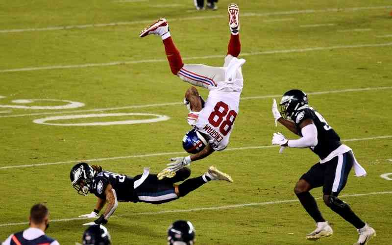 Giants player getting flipped by an Eagles player