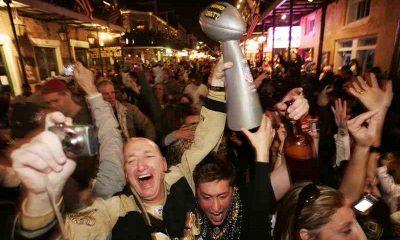 Saints fans celebrating on Bourbon Street