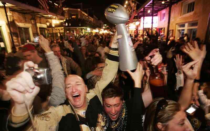 Saints fans celebrating on Bourbon Street