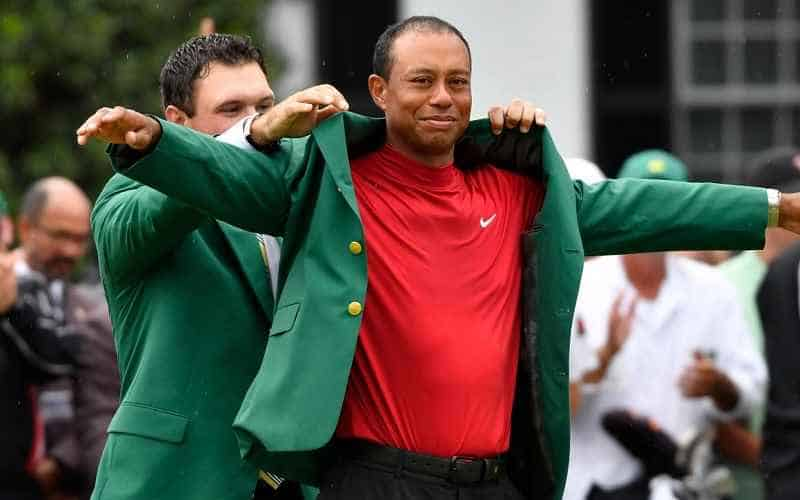Tiger Woods putting on green jacket at Masters 2019
