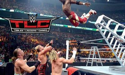 WWE Wrestler jumping off of a ladder onto other wrestlers