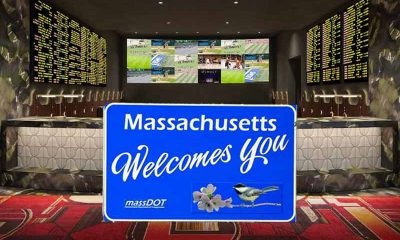 A Legal Sportsbook In Massachusetts with a state welcome sign in front