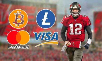 tampa bay buccaneers qb tom brady with bitcoin, litecoin, visa, and mastercard logos
