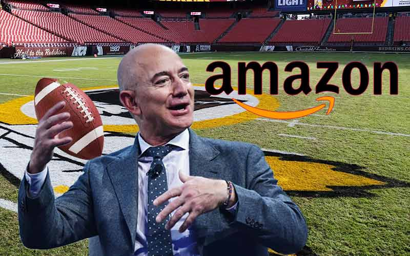 Amaon's Jeff Bezos throws a football while he considers his NFL betting odds to purchase the Washington Football Team